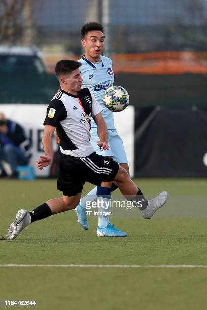 Rafael Bandeira of Juventus Turin U19 and Oscar Castro of Atletico Madrid U19 battle for the ball during the UEFA Youth League match between Juventus...