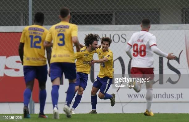 Rafael Barbosa of GD Estoril Praia celebrates with teammate Daniel Braganca of GD Estoril Praia after scoring a goal during the Liga Pro match...