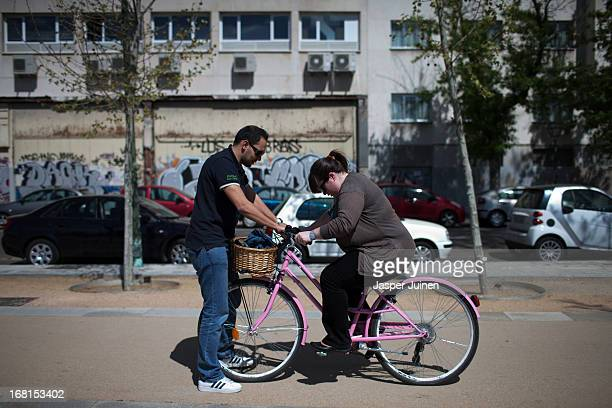 Rafael Barroso 27 yearsold from Mellila helps Judit Herrera 27 yearsold from Madrid to learn to ride a bicycle a popular method of transport in the...