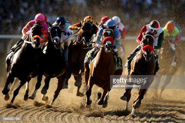 Rafael Bejarano riding Goldencents leads the field into the first turn of the Dirt Mile during the 2013 Breeders' Cup World Championships at Santa...