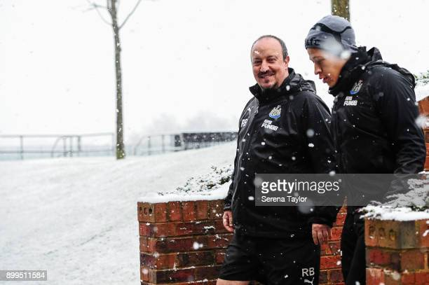 Rafael Benitez and Dwight Gayle walk down the stairs during the Newcastle United Training session at the Newcastle United Training Centre on December...