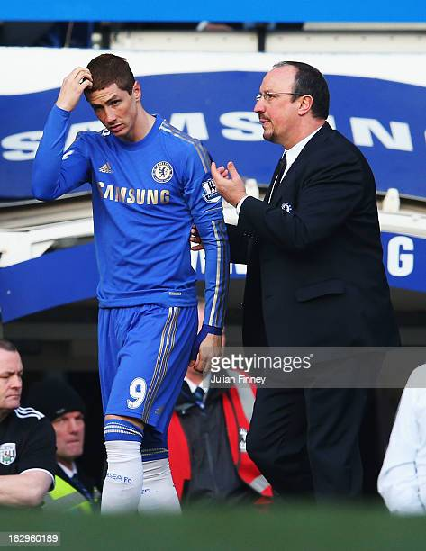 Rafael Benitez interim manager of Chelsea talks to Fernando Torres as he prepares to come on as a substitute during the Barclays Premier League match...