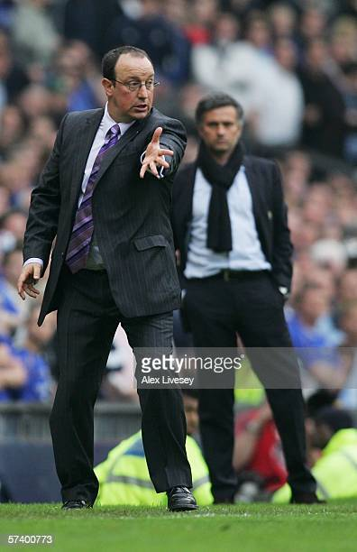 Rafael Benitez manager of Liverpool gives instructions as Jose Mourinho manager of Chelsea looks on during the FA Cup SemiFinal match between Chelsea...