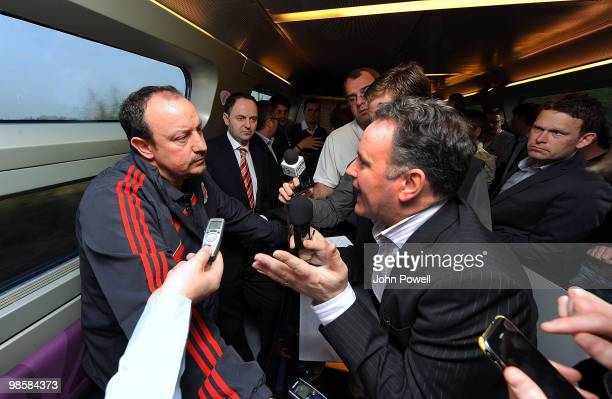 Rafael Benitez manager of Liverpool speaks to reporters during a press briefing in the buffet car of a train travelling from Paris to Bordeaux on...