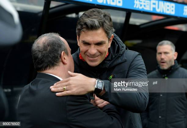 Rafael Benitez Manager of Newcastle United and Mauricio Pellegrino Manager of Southampton embrace prior to the Premier League match between Newcastle...