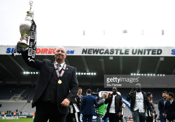 Rafael Benitez, Manager of Newcastle United celebrates with the Championship trophy after the Sky Bet Championship match between Newcastle United and...