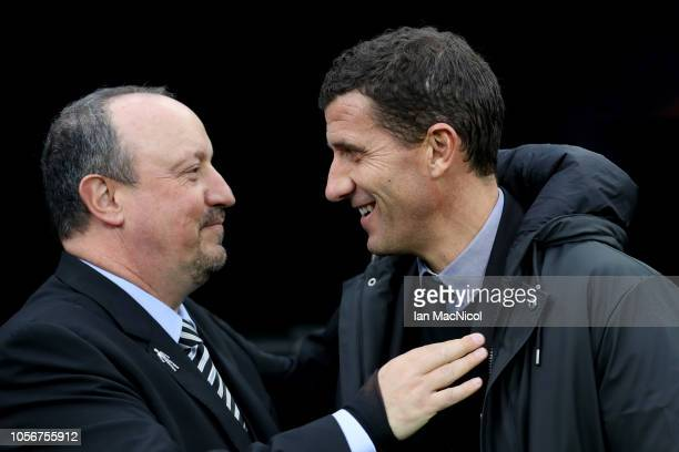 Rafael Benitez Manager of Newcastle United embraces Javi Gracia Manager of Watford ahead of the Premier League match between Newcastle United and...