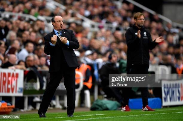 Rafael Benitez Manager of Newcastle United gives his team instructions as Jurgen Klopp Manager of Liverpool looks on during the Premier League match...