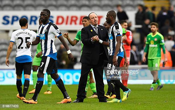 Rafael Benitez manager of Newcastle United shakes hands with Chancel Mbemba of Newcastle United after the Barclays Premier League match between...