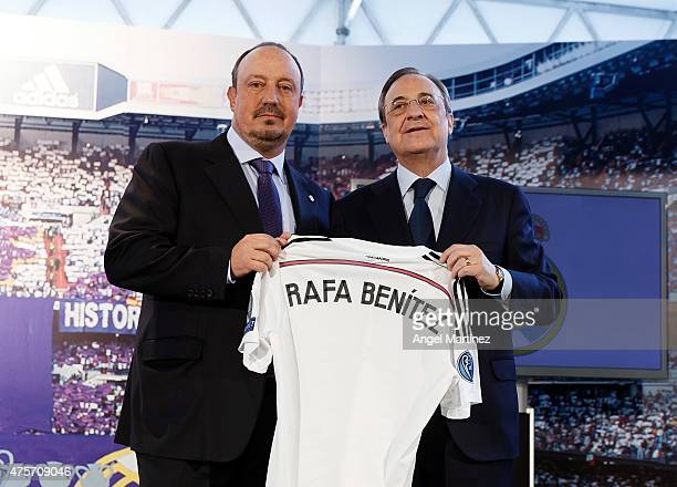 Rafael Benitez pose with president Florentino Perez during his official unveiling as the new Real Madrid manager at Estadio Santiago Bernabeu on June...