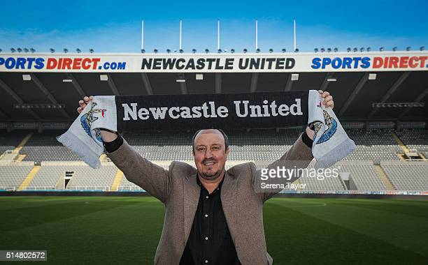Rafael Benitez poses for photographs holding a club shirt pitch side after signing as Newcastle United's new manager at StJames' Park on March 11 in...