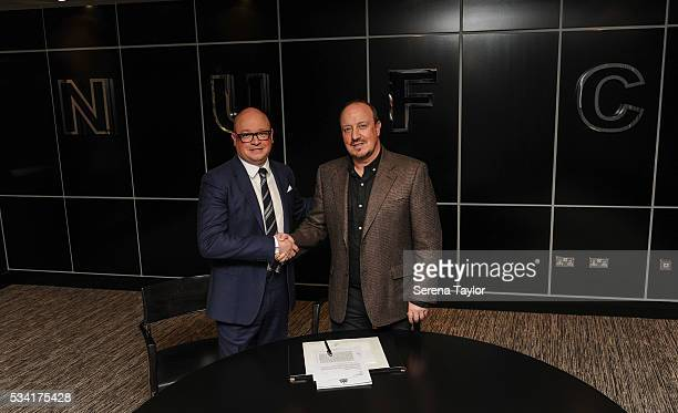 Rafael Benitez signs a new contract as Newcastle United's manager with managing director Lee Charnley at StJames' Park on May 25 in Newcastle upon...