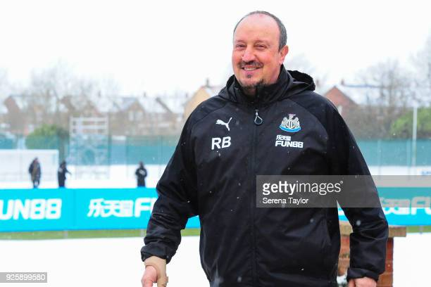 Rafael Benitez smiles as he walks outside during the Newcastle United Training Session at the Newcastle United Training Centre on March 1 in...