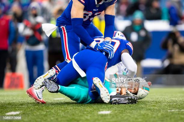 Rafael Bush of the Buffalo Bills sacks Ryan Tannehill of the Miami Dolphins during the first quarter at New Era Field on December 30 2018 in Orchard...