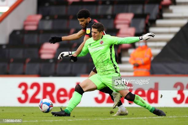 Rafael Cabral Barbosa of Reading is challenged by Dominic Solanke of AFC Bournemouth, as Dominic Solanke of AFC Bournemouth then goes on to score his...