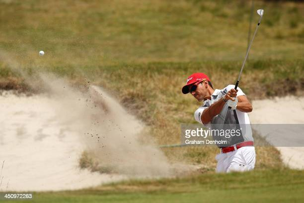 Rafael Cabrera Bello of Spain plays a shot from the bunker during day one of the World Cup of Golf at Royal Melbourne Golf Course on November 21 2013...
