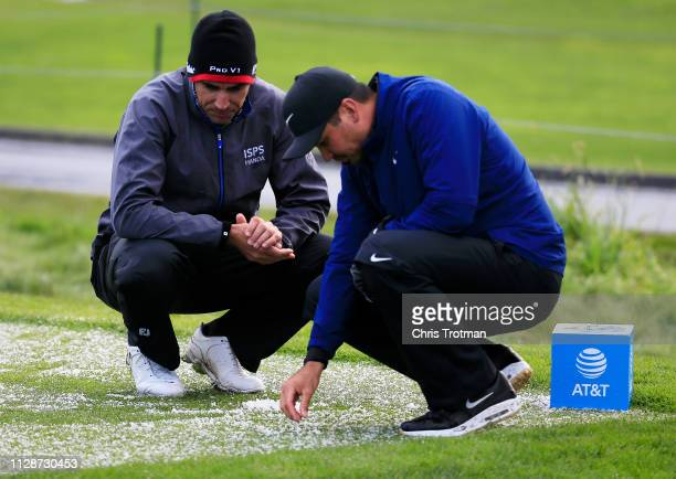 Rafael CabreraBello of Spain and Jason Day of Australia look at hail accumulation on the third tee during the final round of the ATT Pebble Beach...