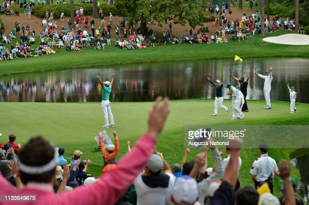 Rafael Cabrera-Bello of Spain celebrates with playing partners S∞ren Kjeldsen and Michael Campbell of New Zealand after putting backwards on No. 9...