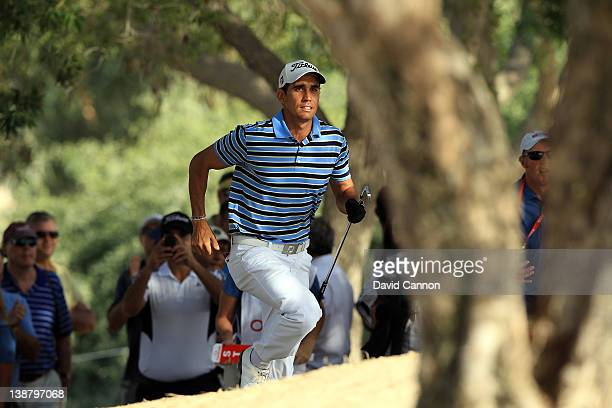 Rafael CabreraBello of Spain follows his great escape from the sand in the trees for his second shot on the 16th hole during the final round of the...