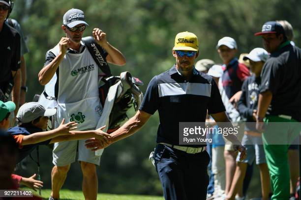 Rafael Cabrera-Bello of Spain high fives fans during the final round of the World Golf Championships-Mexico Championship at Club de Golf Chapultepec...