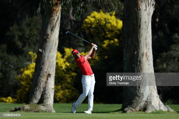 Rafael CabreraBello of Spain plays a shot on the 13th hole during the second round of the Genesis Invitational at Riviera Country Club on February 14...