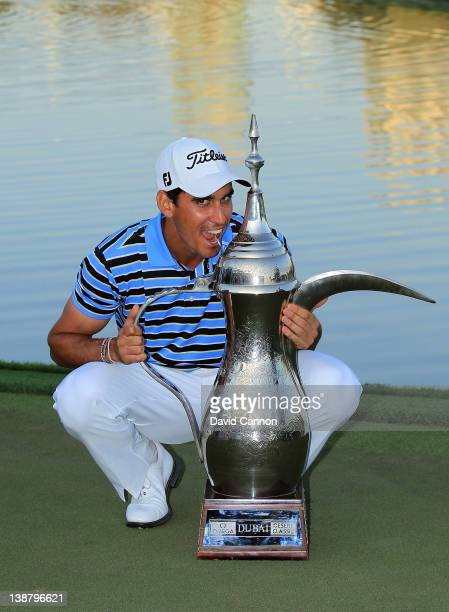 Rafael CabreraBello of Spain poses with the trophy after his win in the final round of the 2012 Omega Dubai Desert Classic on the Majilis Course at...