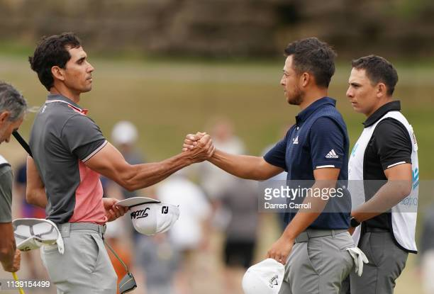 Rafael CabreraBello of Spain shakes hands with Xander Schauffele of the United States after defeating him 1up during the third round of the World...