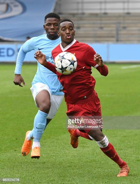 Rafael Camacho of Liverpool and Tom DeleBashiru of Manchester City in action during the Manchester City v Liverpool UEFA Youth League game at...