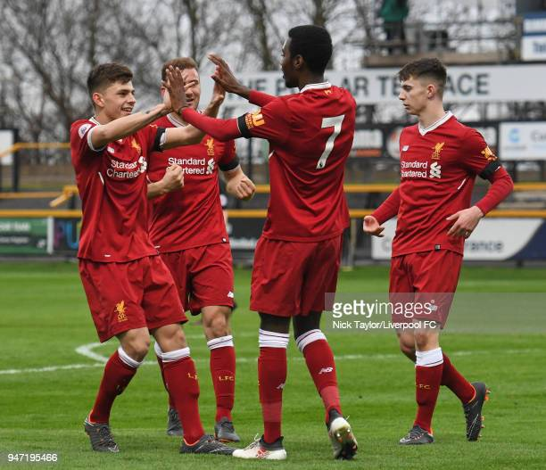 Rafael Camacho of Liverpool celebrates with team mates Adam Lewis Herbie Kane and Ben Woodburn after his cross is inadvertently turned into his own...