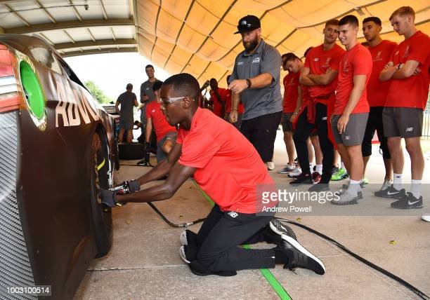 Rafael Camacho of Liverpool changing tyres during a tour of Roush Fenway Racing on July 21 2018 in Charlotte North Carolina