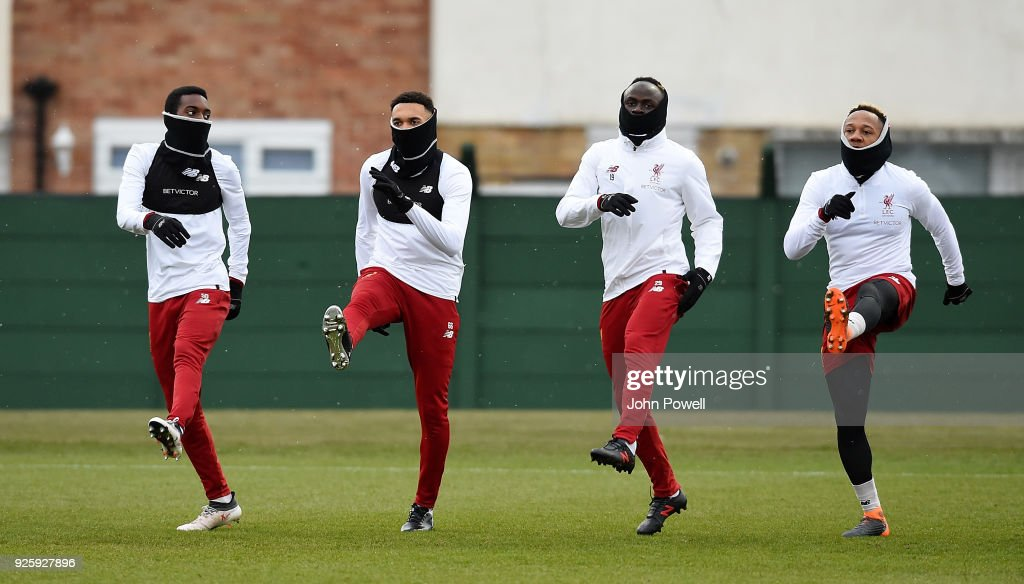 Rafael Camacho, Trent Alexander-Arnold, Sadio Mane and Nathaniel Clyne of Liverpool during a training session at Melwood Training Ground on March 1, 2018 in Liverpool, England.