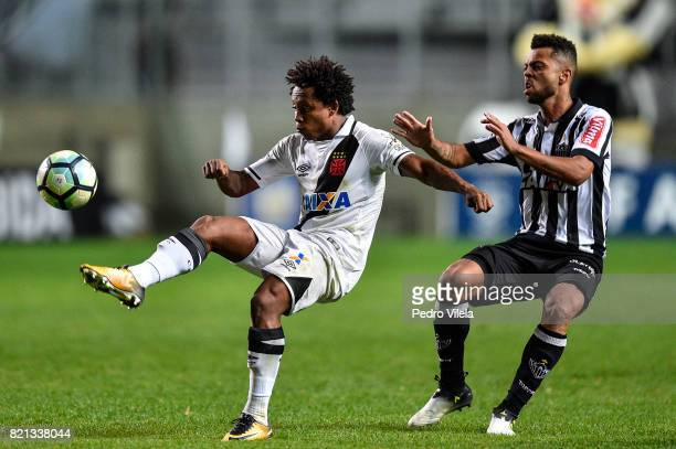 Rafael Carioca of Atletico MG and Paulo Vitor of Vasco da Gama battle for the ball during a match between Atletico MG and Vasco da Gama as part of...