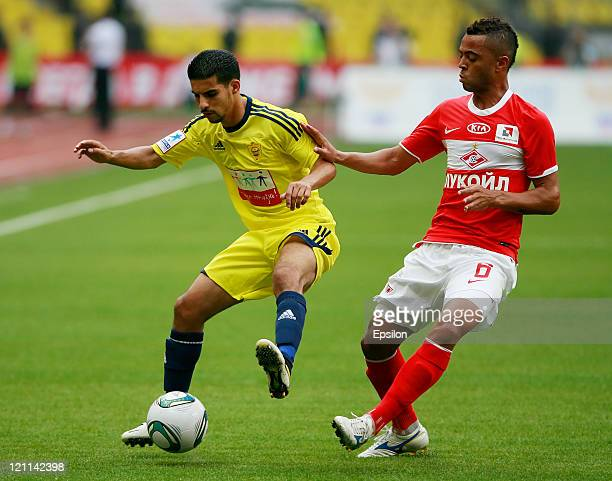Rafael Carioca of FC Spartak Moscow battles for the ball with Mbark Boussoufa of FC Anzhi Makhachkala during the Russian Football League Championship...