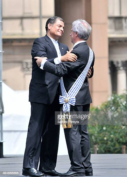 Rafael Correa president of Ecuador presents his compliments to the new president of Uruguay Tabaré Vázquez at Independence Square in Montevideo on...