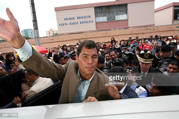 Rafael Correa waves to supporters after voting in Ecuador's presidential election Sunday October 15 2006 in Quito Ecuador Correa who served a...