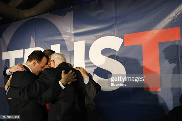 Rafael Cruz right father of Senator Ted Cruz a Republican from Texas and 2016 presidential candidate prays on stage with advisors during the Cruz...