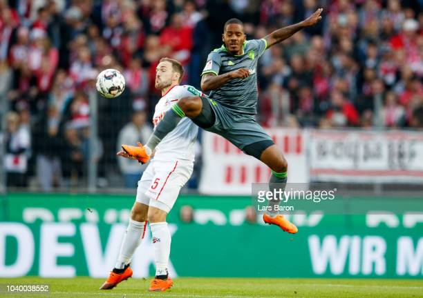 Rafael Czichos of Koeln challenges Charlison Benschop of Ingolstadt during the Second Bundesliga match between 1 FC Koeln and FC Ingolstadt 04 at...