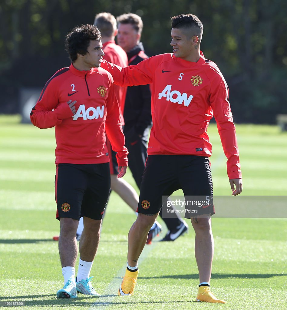 Rafael da Silva and Marcos Rojo of Manchester United in action during a first team training session at Aon Training Complex on September 26, 2014 in Manchester, England.