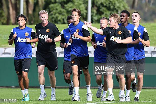 Rafael da Silva Manager David Moyes Adnan Januzaj and fitness coach Gary Walker of Manchester United in action during a first team training session...