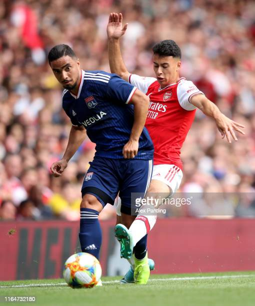 Rafael Da Silva of Lyon is closed down by Gabriel Martinelli of Arsenal during the Emirates Cup match between Arsenal and Olympique Lyonnais at...