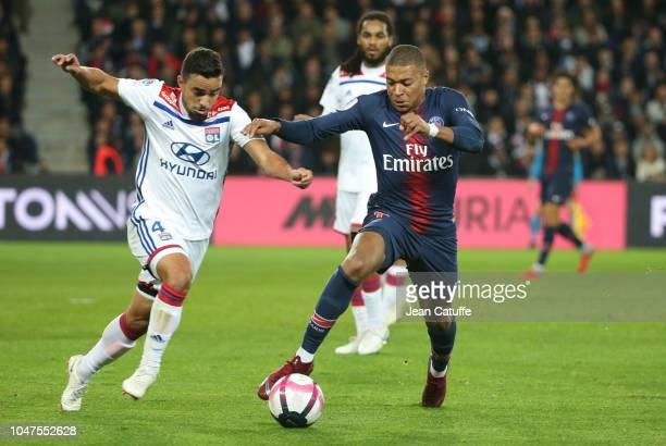 Rafael Da Silva of Lyon Kylian Mbappe of PSG during the french Ligue 1 match between Paris SaintGermain and Olympique Lyonnais at Parc des Princes...