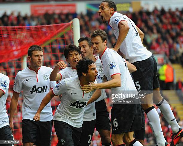 Rafael Da Silva of Manchester United celebrates scoring to make it 10 with team mates during the Barclays Premier League match between Liverpool and...