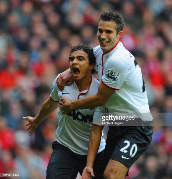 Rafael Da Silva of Manchester United celebrates scoring to make it 1-0 with Robin Van Persie during the Barclays Premier League match between...