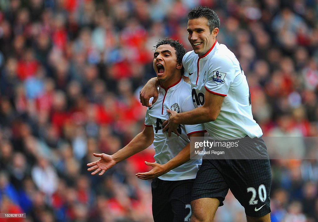 Rafael Da Silva of Manchester United celebrates scoring to make it 1-0 with Robin Van Persie during the Barclays Premier League match between Liverpool and Manchester United at Anfield on September 23, 2012 in Liverpool, England.