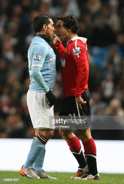 Rafael Da Silva of Manchester United clashes with Carlos Tevez of Manchester City during the Barclays Premier League match between Manchester City...