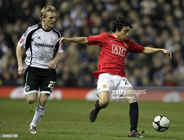 Rafael Da Silva of Manchester United clashes with Gary Teale of Derby County during the FA Cup sponsored by eon Fifth Round match between Derby...