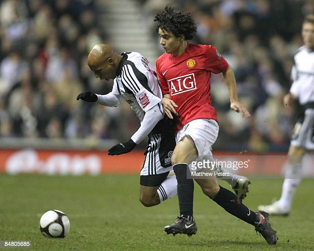 Rafael Da Silva of Manchester United clashes with Jordan Stewart of Derby County during the FA Cup sponsored by eon Fifth Round match between Derby...