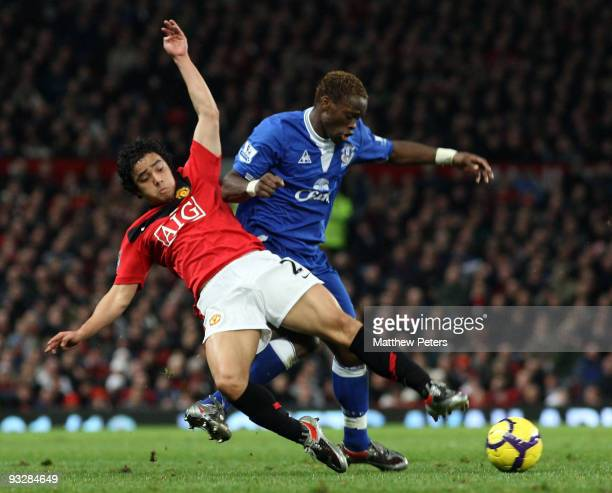 Rafael Da Silva of Manchester United clashes with Louis Saha of Everton during the Barclays Premier League match between Manchester United and...
