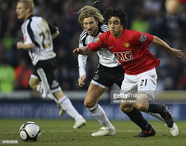 Rafael Da Silva of Manchester United clashes with Robbie Savage of Derby County during the FA Cup sponsored by eon Fifth Round match between Derby...