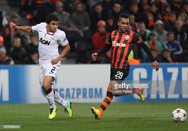Rafael da Silva of Manchester United in action with Alex Teixeira of Shakhtar Donetsk during the UEFA Champions League Group A match between Shakhtar...
